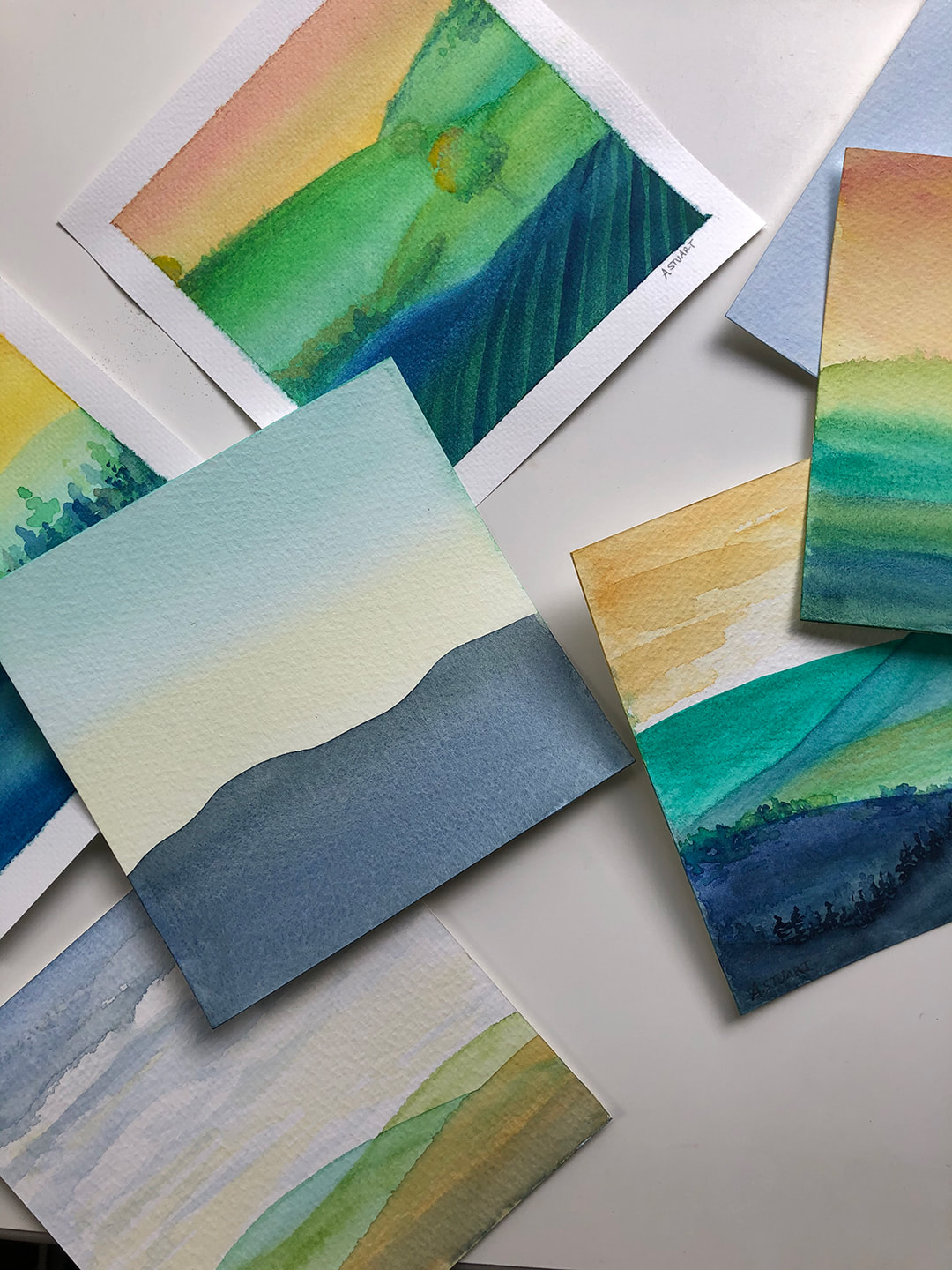 Layers of landscape paintings by Ashley Stuart